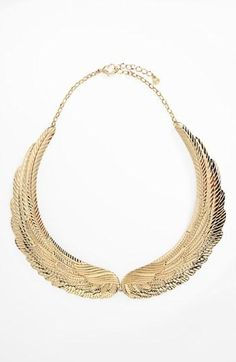 Love this wing necklace!