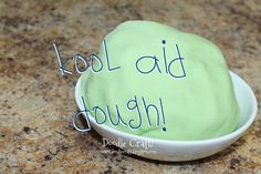 Kool-Aid® Playdough!  Easy to make: 3 Cups flour, 1/2 cup salt, 1 pkg of kool-aid, 1 tablespoon baking powder, and 2 cups boiling water!  Air tight container keeps for weeks!  :)