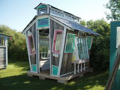 Cool playhouse for the kiddies...when they outgrow it, you can turn it into a greenhouse.  Great idea for recycling scrap wood from other projects and old windows.