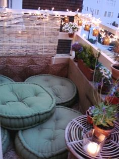 patio floor pillow area and potted garden... wow... can i live here now?