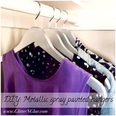 DIY metallic silver spray painted wood hangers. Tutorial via Glitter 'N Glue