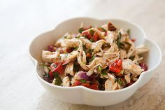 A cool twist on a simple chicken salad, with poached chicken breasts, roasted red bell peppers, toasted almonds, garlic and parsley.