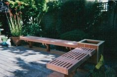 A desire for a traditional redwood backyard oasis was the inspiration for these slotted redwood benches anchored with a corner Japanese-style planter boxes that can be made in several styles