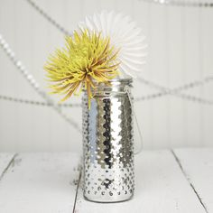 Use this 9.25 inch tall silver hobnail jar in a setting of white and silver for a snowy winter look then add a bold splash of color to make it pop!
