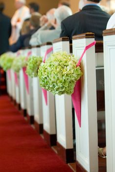 I like the way the flowers are hung around the end of the pew.