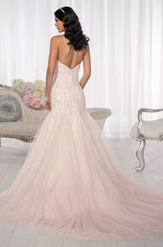 This wedding dress features a sparkling silver beading on pink tulle throughout the fitted bodice. Essense Of Australia, Spring 2014