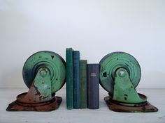 vintage industrial green castor set/bookends. $85.00, via Etsy. If you like this then check out my shop for one of a kind handmade art and decor items https://www.etsy.com/shop/SalehDesigns?ref=si_shop industrial chic vintage reclaimed up cycled repurposed game of thrones gears steampunk welded steel sculptures eclectic decor