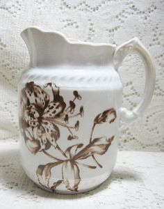 Brown Transferware Embossed Pitcher in Lily Pattern