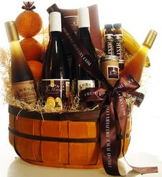 Fall gift basket filled with apple cider, assorted fruits,cheeses,crackers or cocoa packages with marshmellows and boxes of creamy chocolate.what a lovely gift!