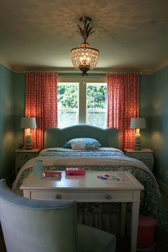 Long, brightly colored curtains behind the headboard. I like it!