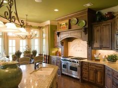 French Country Kitchen Cabinets,love it all but especially the cabinets ,lite over the island ,even the color.