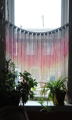 A macrame wall-hanging makes a striking curtain.