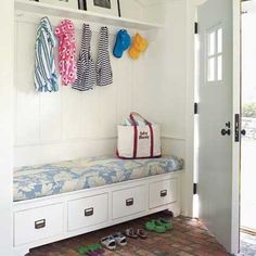 Sweet brick-floored mudroom with a boot bench that doubles as storage for flip-flops. | Photo: Tria Giovan | thisoldhouse.com