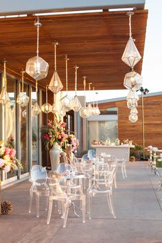A gorgeous outdoor lounge embellished with geometric lanterns for a modern, beachside wedding.  Designed by Alchemy Fine Events  www.alchemyfineevents.com