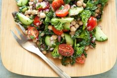 Mediterranean Crunch Salad | 1 can no-salt-added garbanzo beans  1 cucumber chopped  1 cup small broccoli florets  1 cup grape tomatoes halved  1 cup finely sliced kale tough stems removed  1/2 cup finely chopped red onion  2 tablespoons finely chopped Kalamata olives  3 tablespoons red wine vinegar  1 clove garlic minced  1 tablespoon chopped fresh parsley  1 teaspoon chopped fresh thyme