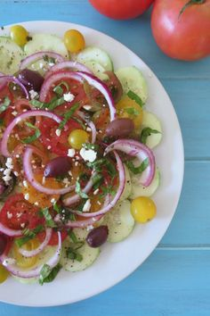 Cucumber and Tomato Summer Time Salad - A light, refreshing Mediterranean salad made with cucumbers tomatoes and topped with a simple balsamic dressing.