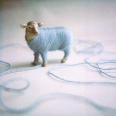 DIY: yarn & plastic animal