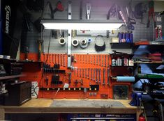 Don't be afraid to mix it up! Using varying colors with your Wall Control pegboard you can create a clean custom look for your workspace! This Wall Control customer went with orange metal pegboard to match their Harley and then surrounded it with gray and galvanized metal pegboard to make it pop!