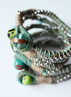 style-diaries: jewelry made from scrap fabric, twine, bead and pull chain (like the ones on ceiling fans). Cool!