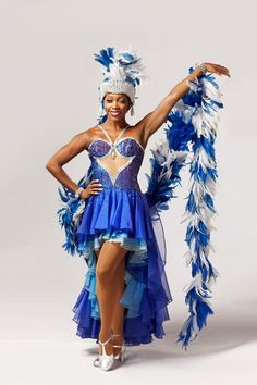"""The Rockettes """"Gershwin Boa"""" costume was designed by Erté and was introduced in 1990. #feathers #rockettes #blue #NYC #costumes #dancers"""