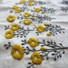 These embroidered flowers.