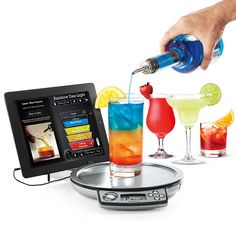 Perfect Drink App-Controlled Smart Bartending | A revolution in home bartending, Perfect Drink's smart scale and free app let you choose from hundreds of drink recipes, follow real-time pouring instructions, and watch as a virtual glass fills on your smartphone or tablet. That way, you know exactly how much to pour and when to stop—for perfect drinks, every time.   #kitchen #cooking #Baking #gadgets #tools #Appliances #cocktail #drinks #bartender #party
