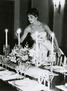 Jackie Kennedy preparing for the young couple's first dinner party in their Georgetown home, photographed by Orlando Suero, 1954