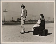 """""""Young family, penniless, hitchhiking on U.S. Highway 99, California. The father, twenty-four, and the mother, seventeen, came from Winston-Salem, North Carolina, early in 1935. Their baby was born in the Imperial Valley, California, where they were working as field laborers."""" California 1936"""