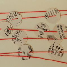 Music Notes Paper Garland on Red Floss by AlteredStory on Etsy, $6.00