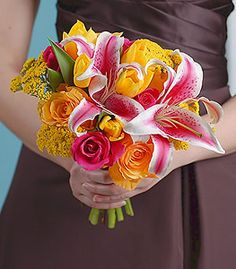 possible bouquet for me! Wedding colors would be light blue or tealish and yellow... I like adding the lillies because Danny always gets me them and they are the first flowers he ever got me.