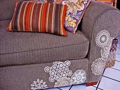 Sofa patched with doillies