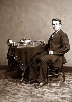 Thomas Edison, as a young man. He is shown with his recording device. It was on this day, November 21, in the year 1877 that Thomas Edison announced the invention of the phonograph.