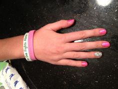 No one fights alone-- volley ball pink night nails