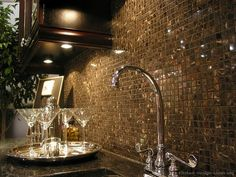 A mosaic tile backsplash featuring 5/8-inch square Michelangelo marble tiles  (Kitchen-Design-Ideas.org)
