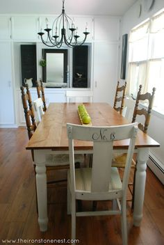 lovely white farmhouse dining room -- mixed chairs, chandelier, love the whole look table bases, dining rooms, dine room, rustic table, kitchen tables, painted tables, dining room tables, table legs, dining tables
