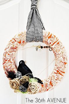 awesome halloween wreath. Love that orange fabric