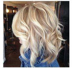 Medium blonde hair cut and color.  Cute color!