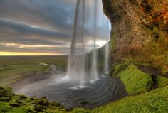 Iceland ~ this waterfall is called Seljalandsfoss.