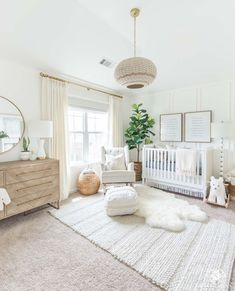 Beautiful gender neutral nursery design with white walls and woodland decor - soft, modern, and a little bohemian. #genderneutralnursery #bohonursery