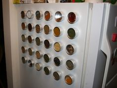 Free up an entire cabinet shelf by putting all your spices in magnetic tins.