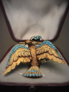 Four coloured-gold trembler bird broochEnglish, about 1850-80