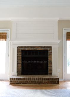 Family room fireplace makeover idea... enclose brick and finish hearth in stone.