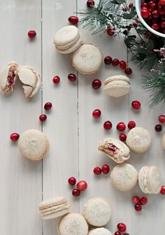 Orange-walnut macarons with spiced cream cheese and cranberry filling.