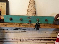 Key holder I made from the front if an old desk drawer front ,the hooks are vintage.