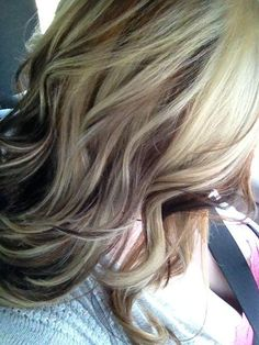 Blonde light brown and dark with a choppy cut. I totally love it but I have brown hair not blonde would love to have this hair-do. :)