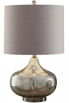 This Soho Mercury Glass Table Lamp from Home Decorators Collection would make a great addition in any living room!