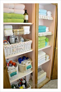 bathroom closet organization; could do the one to the left for upstairs and store towels in the basement/laundry room