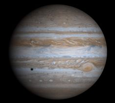 """Jupiter, as imaged by the Cassini spacecraft. (Credit: NASA) The dark spot is the shadow of one of Jupiter's moons. ©Mona Evans, """"Astronomy Photographer of the Year 2011"""" http://www.bellaonline.com/articles/art50195.asp"""