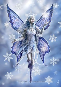 fairy pictures | this snowflake fairy is really enchanting she is pictured amongst beautiful snowflakes...