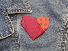 Two neckties and 10 minutes are all you need to make this cute heart, which makes a perfect V-Day pin.